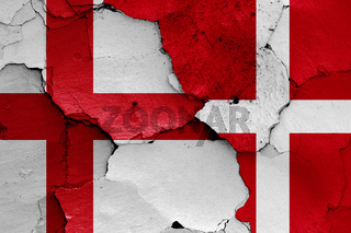 flags of England and Denmark painted on cracked wall