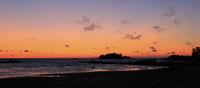 Sunrise view from Vita Sannar, Sweden. Small island and shore of Lake Vanern.