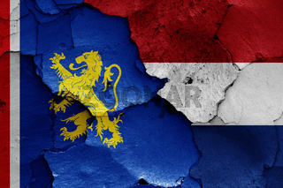 flags of Leeuwarden and Netherlands painted on cracked wall