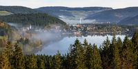 View to the Titisee in morning mist in the Black Forest