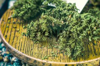 dried cannabis sativa closeup on a table