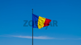 Romanian flag waving on a sunny summer day in Alba Iulia, Romania