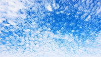 Panorama of the blue sky with fleecy clouds