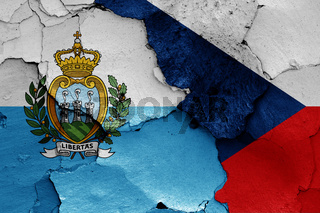 flags of San Marino and Czech Republic painted on cracked wall