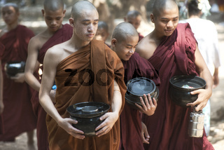 Monks Going for Lunch at Kalaywa Tawya Monastery in Yangon. February 23, 2014 - Yangon, Myanmar