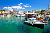 Krk island. Town of Njivice turquoise harbor and waterfront