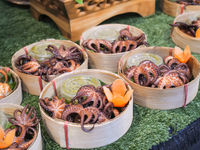 Grilled octopus tentacles with seafood sauce