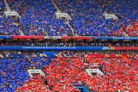Moscow, Russia - June 14, 2018: Fans on the stadium Luzhniki raising russian flag at the opening match of the Football World Cup in Russia 2018