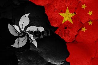 flags of Hong Kong and China painted on cracked wall