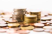 Piles of  Euro coins  on white background. Money.