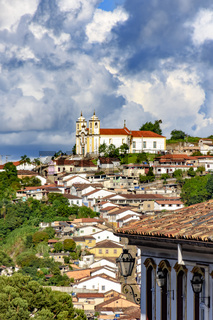 Cityscape of Ouro Preto city, church and hills