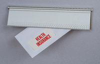 A letter in a mail slot - Health Insurance