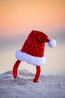 Sparkly red santa hat in the beach sand in Australia. Christmas