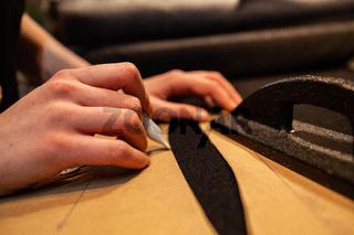 Fashion designer marking sewing patterns