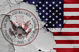 flags of National Archives and Records Administration and USA painted on cracked wall