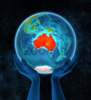 Australia on Earth in hands