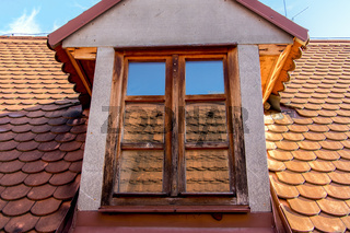 House Roof and Attic Windows with reflection of roof tiles.