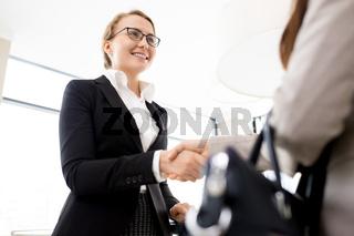 Greeting Business Partner with Handshake