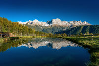 Reflections of the Rosengarten mountains in the water of the Wuhnleger pond near Tiers