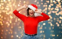 happy young woman in santa hat on christmas