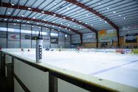 drink bottle on board ice hockey rink
