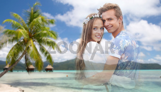 hippie couple fading over exotic beach background