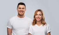 portrait of happy couple in white t-shirts