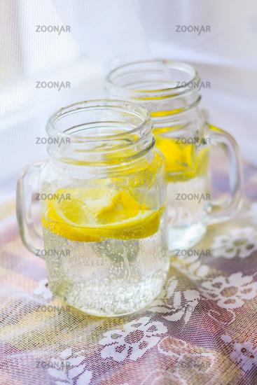 Glasses with homemade lemon lemonade. cold drink. Carbonated drink