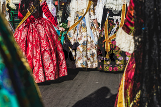 Valencia, Spain - March 17, 2019: Detail of the typical fallero dress, during the colorful and traditional parade of the offering, handmade embroidered dresses for the falleras.