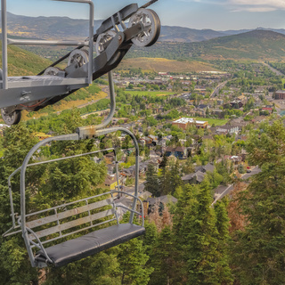 Square frame Focus on a chairlift with view of the ski resort in Park City Utah during summer