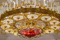 Moscow, Russia, 23 October 2019: Big bronze chandelier in Tavrichesky hall interior in State historical and architectural museum reserve Tsaritsyno, Russia. Tauride hall. Gold Chandelier