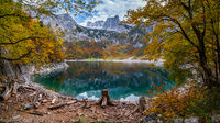 Picturesque Hinterer Gosausee lake, Upper Austria. Colorful autumn alpine view of mountain lake with clear transparent water and reflections. Dachstein summit and glacier in far.