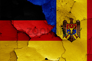 flags of Germany and Moldova painted on cracked wall