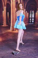Tall, slim, sexy, busty redhead model dressed as Cinderella