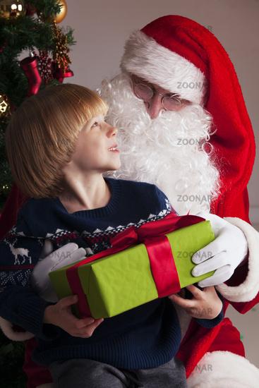 Boy on santa claus knees