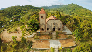 Church on a hill in Malbato village. Philippines. Coron. Palawan. Aerial view.