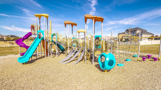 Panorama Kids playground with colorful blue slides during day