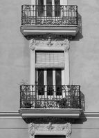 Old facade with balcony in Valencia.