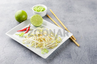 Bean sprouts in white plate.