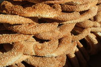 Koulouri - Greek snack a circular Greek bread with sesame seeds. Often sold by street vendors. They are similar to Turkish bread