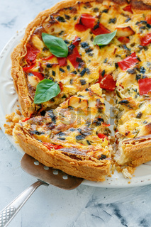 Piece pie of chicken, onion and sweet pepper.