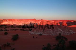 Sunrise at sandstone formation in the Sahara desert near Yoa Lake group of Ounianga Kebir, Ennedi, Chad