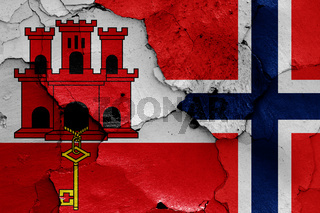 flags of Gibraltar and Norway painted on cracked wall