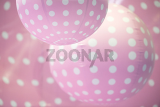 Pink balls with white dots background