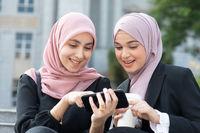 Muslim women using smart phone