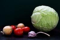 Raw vegetables on dark background