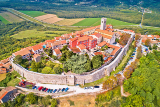 Motovun. Aerial view of idyllic hill town of Motovun surrounded by defense stone walls and Mirna river valley.