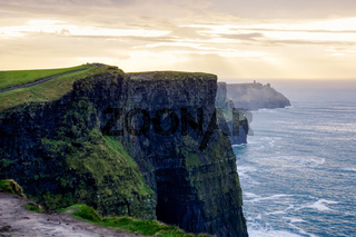 Cliffs of Moher in Wild Atlantic Way with ruins of tower on edge of cliff