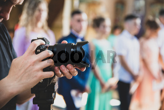 Professional videographer provides services of filming ceremonial event, matte toning effect