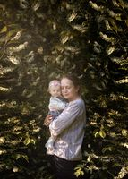 Portrait of mother and small daughter in beautiful landscape. Mother and child portrait.